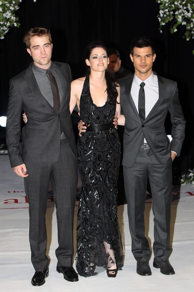 Robert Pattinson, Kristen Stewart e Taylor Lautner em Londres  (Foto: Agência/Getty)