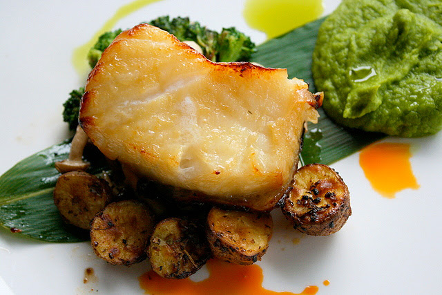 Chilean Seabass, miso marinated and served with sauteed mushrooms and mashed green peas