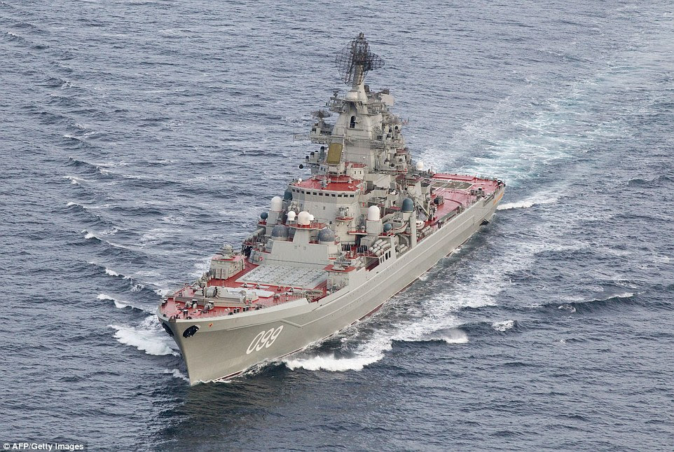 The aircraft carrier is supported by the nuclear-powered battleship Pyotr Velikiy, (Peter the Great) pictured on Monday passing the Norwegian coast by a Lockheed P3-Orion surveillance aircraft