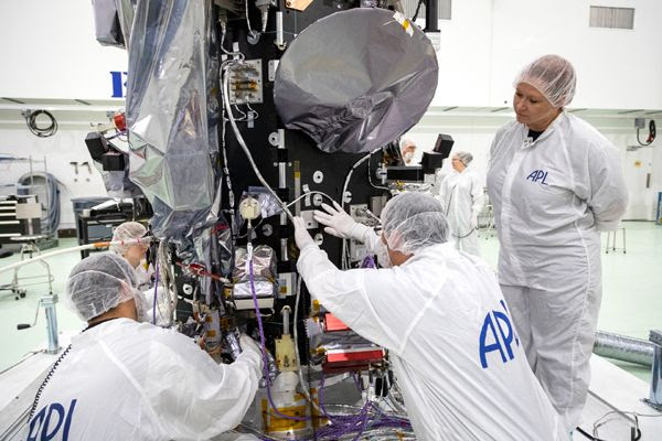 A plaque containing a microchip that bears the names of over 1.1 million people is attached to NASA's Parker Solar Probe at Astrotech Space Operations in Titusville, Florida...on May 18, 2018.
