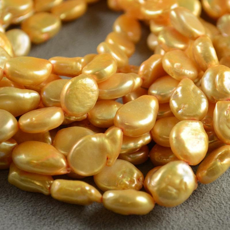 s35602 Freshwater Pearls - 11 x 13.5 mm Flat Oval Pearl - Gold (strand)
