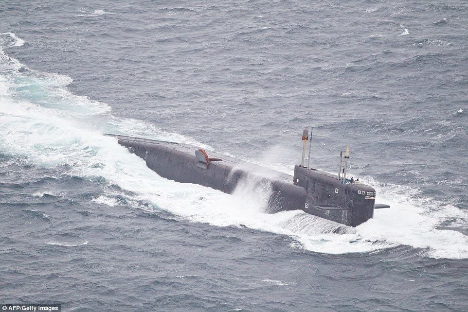 The Russians have also sent a submarine, pictured, to protect the aircraft carrier fleet