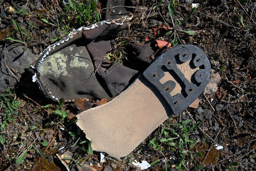 The heel of an old boot, left on the ground.