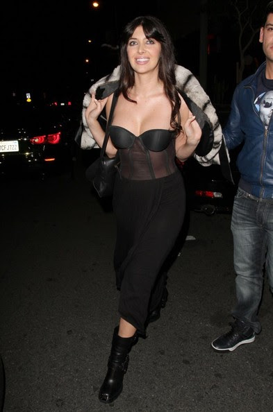 Socialite Brittny Gastineau is all smiles as she leaves Bootsy Bellows nightclub on January 14, 2014 in West Hollywood, California.