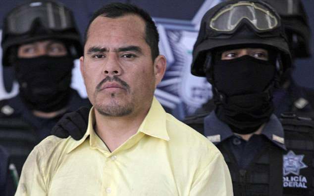 Wanted: Marco Antonio Guzman, aka El Brad Pitt is paraded before the news media in Mexico City following his arrest