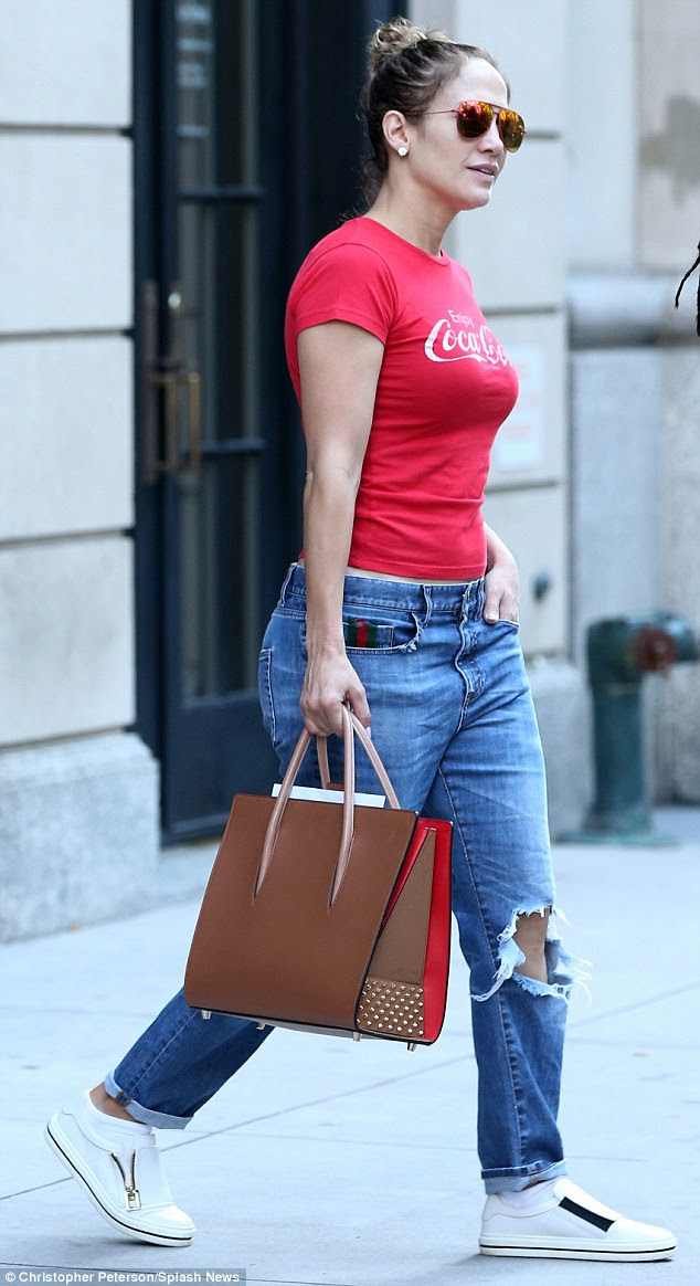 Low key Latina! Jennifer Lopez looked  casdual in a red Coca-Cola branded T-shirt and ripped jeans as she made her way home after filming scenes on the New York City set of her returning TV show, gritty police drama Shades Of Blue