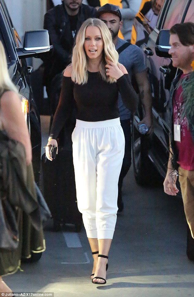 Stepping out: The mother-of-two looked fab in a long-sleeved black top and high-waist white trousers