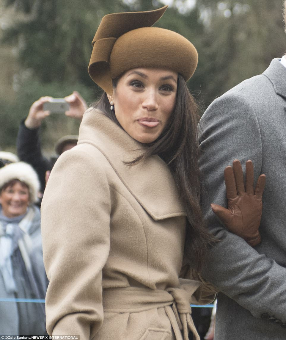 In a cheeky moment, Meghan is pictured sticking her tongue out while waving at the assembled crowds outside the church on their way back to Sandringham House