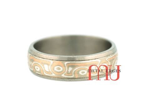Mokume gane and titanium wedding ring. Custom made in