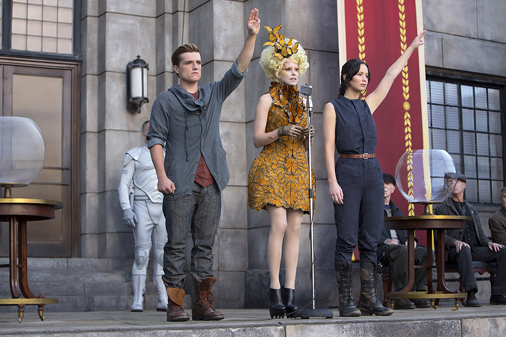 Click to enlarge. Jennifer Lawrence, Josh Hutcherson, and Elizabeth Banks in 'The Hunger Games: Catching Fire' (Lionsgate)