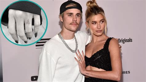 hailey bieber ring finger tattoo honor justin