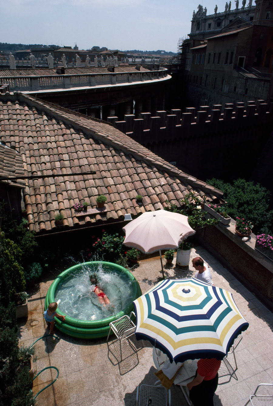 A married Swiss Guard and his family enjoy a patio pool at their compound in Vatican City, 1985.Photograph by James L. Stanfield, National Geographic