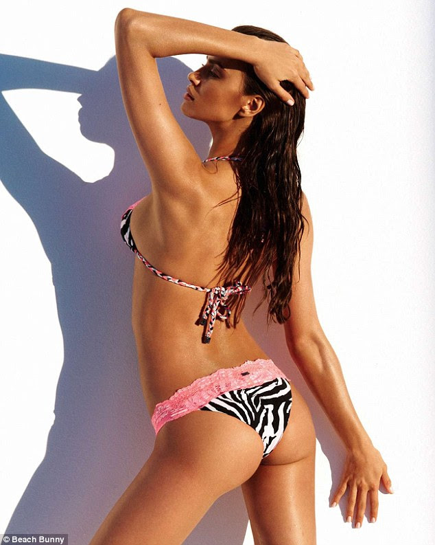 She must work out: Irina Shayk poses in an array of bikinis sowing off her impressive physique for the campaign