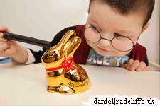 Updated: Daniel Radcliffe signs a Lindt gold plated bunny for celebrity auction