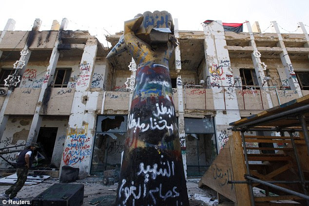 Ransacked: Gaddafi's Bab Al Azaziya compound in Tripoli is trashed - the dictator's whereabouts is still unknown