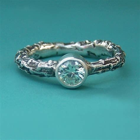 Eco chic organic engagement ring with textured band and