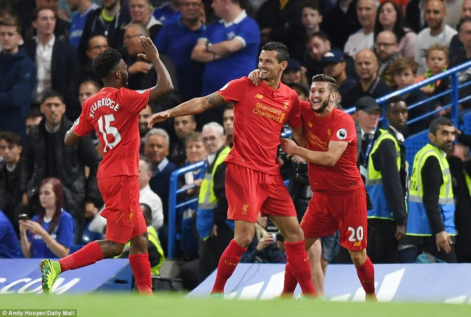 Dejan Lovren, returning to the side after an eye injury, celebrates his opening goal with Daniel Sturridge (L) and Adam Lallana