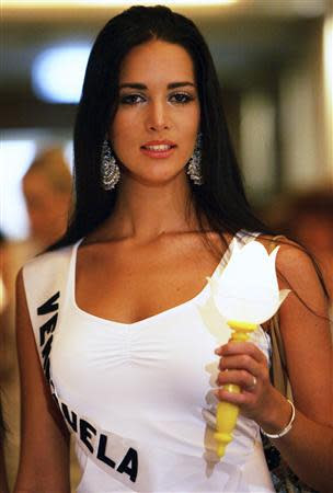 File photo of Miss Universe 2005 contestant Monica Spear of Venezuela taking part in an AIDS candlelight memorial in a Bangkok hotel