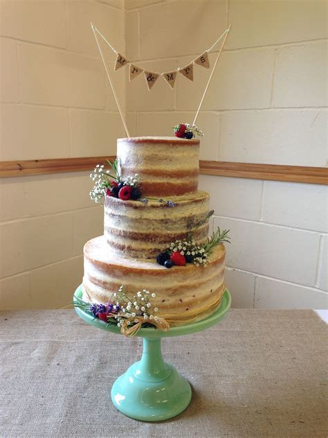 My first naked wedding cake. Top tier lemon, Middle tier