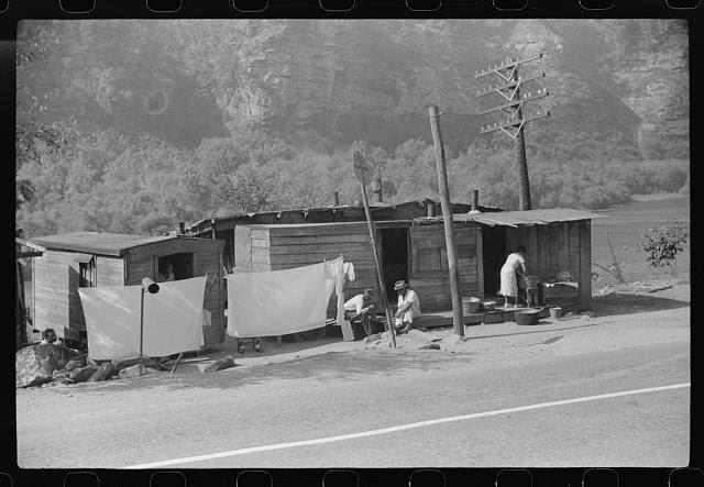 Shacks being inhabited by Negroes along highway between Charleston and Gauley Bridge, West Virginia