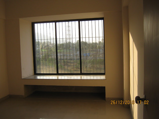 Window in the living room of a 1 BHK Flat in Mahavir Natura, almost Ready for Possession 1 BHK & 2 BHK Flats at Talegaon MIDC Junction on Old Mumbai Pune Highway (NH4) at Vadgaon Maval, Pune 412 106
