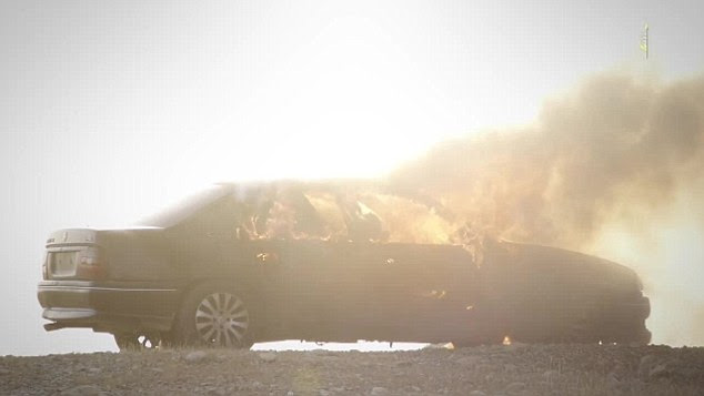 Smoke: The car is seen in flames meaning the badly injured victims are likely to have  burned to death
