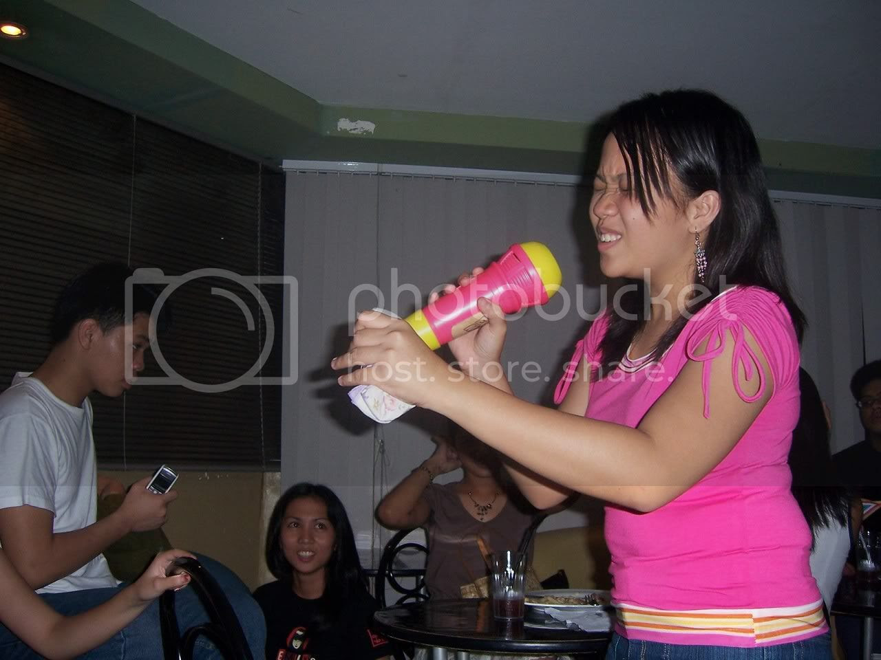 One of my favorite random shots - singing sensation Ariane doing her stuff when that bad vocalist ruined our nights. Image hosted by Photobucket