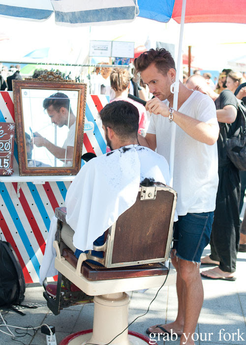 Outdoor barber at the Lost & Found Fashion Market on Barceloneta Beach, Barcelona