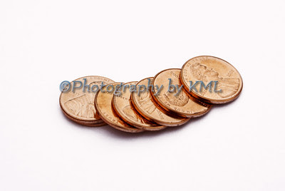 copper penny coins in a line