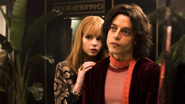 Queen lead singer Freddie Mercury (Rami Malek) and his soulmate Mary Austin (Lucy Boynton) in BOHEMIAN RHAPSODY.