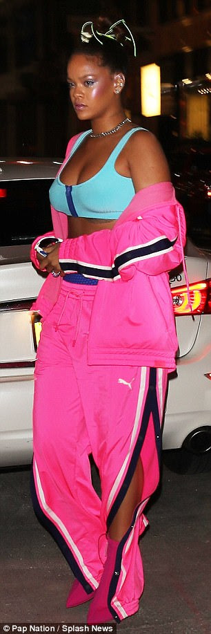 Hot pink:Daring to impress, the Umbrella singer wore a pink Puma track suit - the same athletic company that helped launch her Fenty line