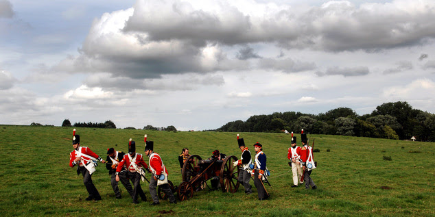 In this June 16, 2007, file photo, actors dressed as soldiers pull a cannon during a re-enactment of the Battle of Waterloo in Braine-l'Alleud, near Waterloo...