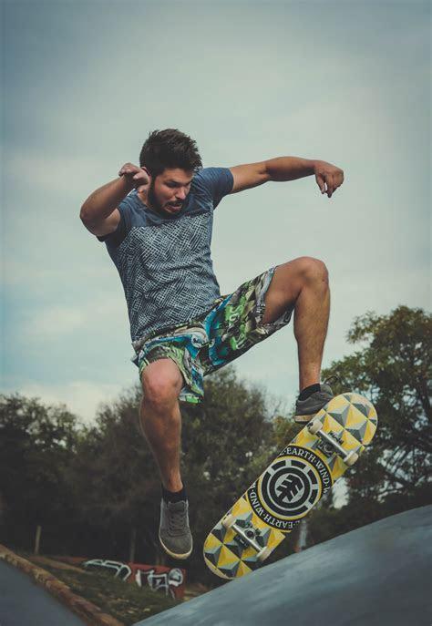 boy skateboarding grayscale photography  stock photo