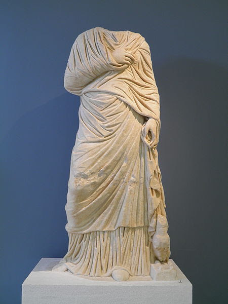 File:Headless life-sized statue of a female figure, she is accompanied by a small dog near her leg left, 2nd century AD, Philippi Museum (7416393560).jpg