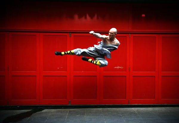 LONDON, ENGLAND - FEBRUARY 23: A Shaolin monk poses for a photograph in Chinatown on February 23, 2015 in London, England. The monks practice Shaolin Kung Fu which is believed to be the oldest institutionalised style of kung fu and are demonstrating their skills while in the UK. (Photo by Carl Court/Getty Images)
