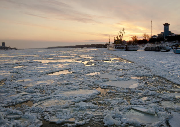Partially frozen Danube waters are seen at sunset, in Giurgiu, southern Romania, Wednesday, Feb. 8, 2012, 2012, back dropped by the Bulgarian bank of the river. Bulgaria and Romania are suspending all