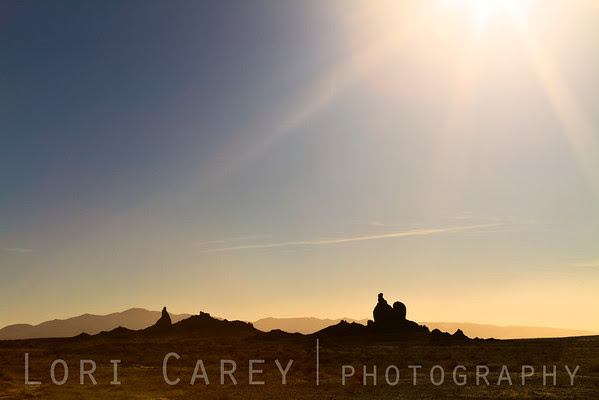Trona Pinnacles silhouette with sunstar
