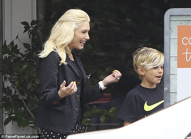 Happy days: The busy star looked delighted to be out with her sons