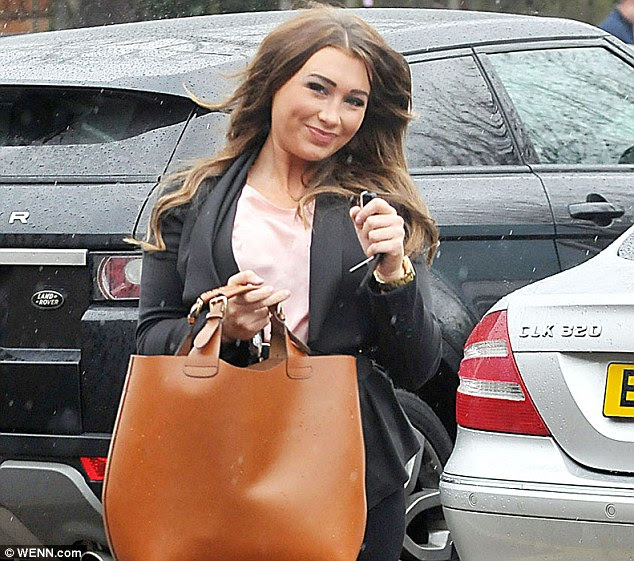 Smiling through: Lauren Goodger looked in good spirits as she arrived at her beauty salon this morning, amid reports she has been axed from TOWIE