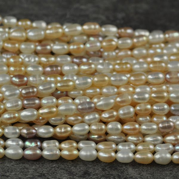 s33784 Freshwater Pearls - 4 x 6 mm Rice Pearl - Natural Mix (strand)