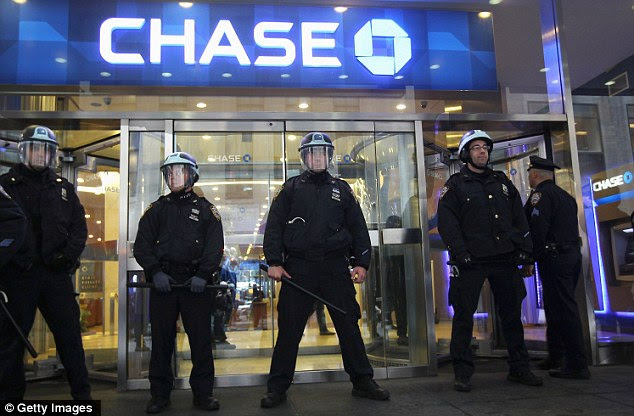 At the ready: Other police stood in riot gear to protect a Chase bank