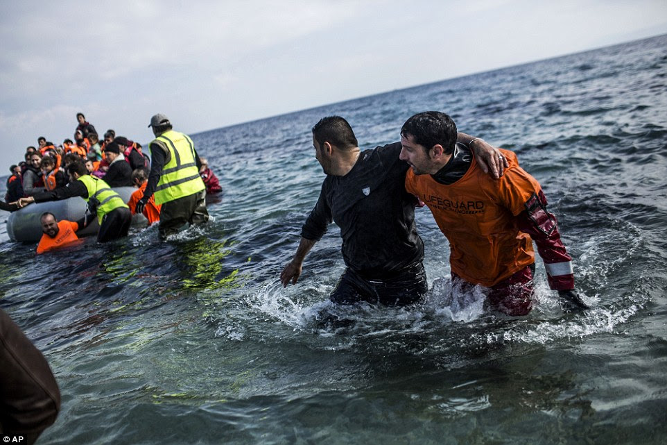 Rescue: Hundreds of migrants continue to arrive by boat after crossing to Greece from Turkey