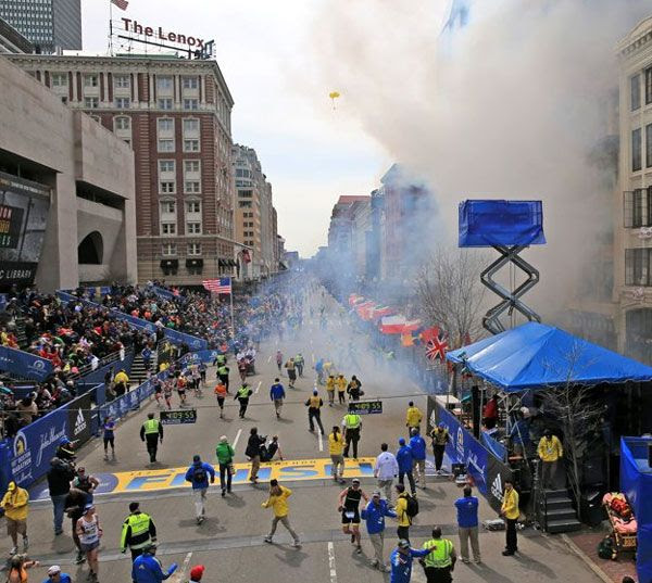 Hundreds of spectators flee after an explosion takes place at the Boston Marathon on April 15, 2013.