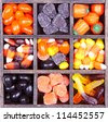 Halloween candy arranged in a printers box, assorted varieties - stock photo