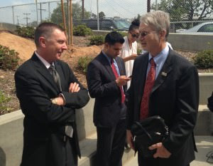 John Deasy, left, Bennett Kayser, right, at a Jerry Brown-led press conference in May