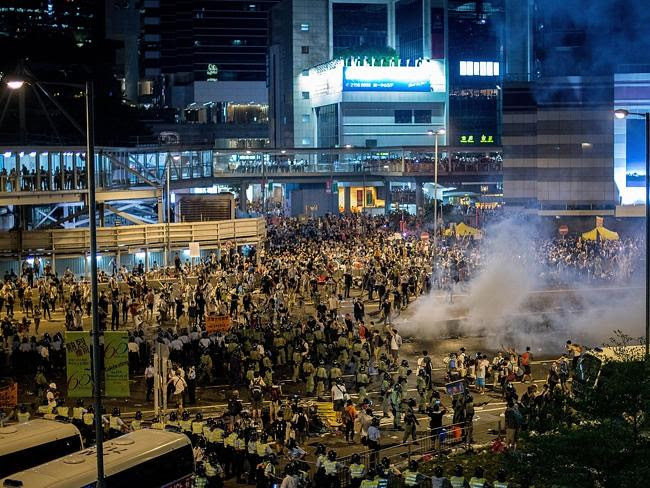 Defiant ... police lobbed canisters of tear gas into the crowd on Sunday evening. Picture