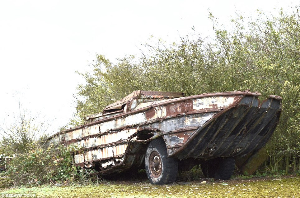 Rusting legend: This DUKW Amphibious vehicle, which was used during the D-Day landings, sits at the closed military site at RAF Folkingham in Lincolnshire, which has become known as a graveyard for historic machinery
