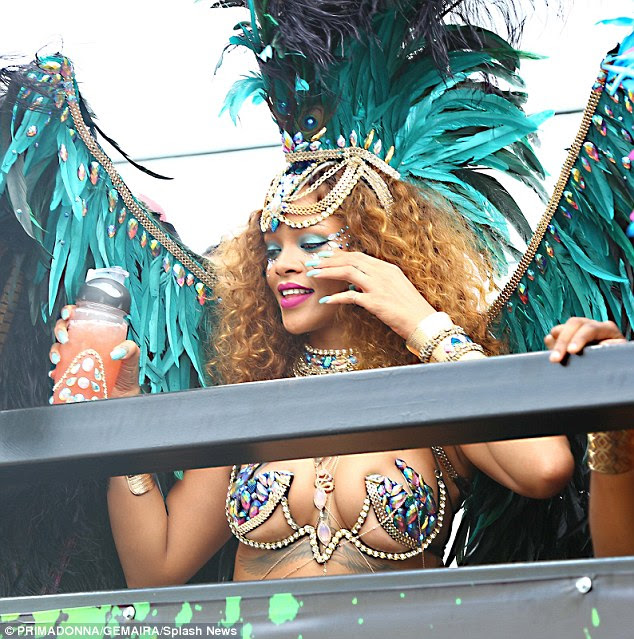 Soaking up the atmosphere: Rihanna watched the crowd from a VIP balcony