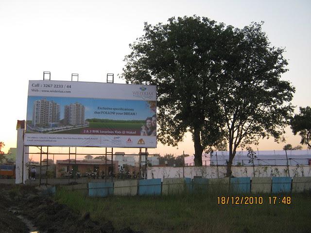 Visit to Wisteriaa - 2 BHK & 3 BHK Flats, at Bhumkar Wasti, near New Poona Bakery, at Wakad Pune 411 057 -  Site hoarding