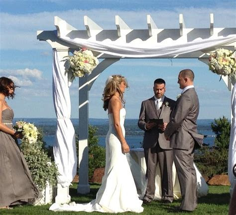 wedding arbor decor with fabric and flowers   Rustic